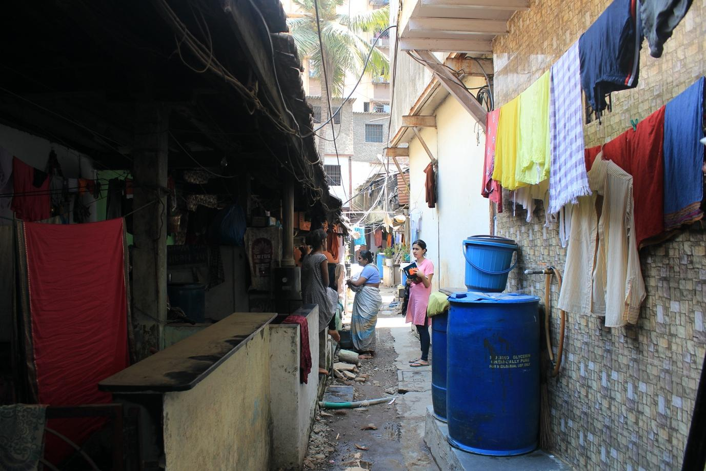 researcher in a bylane in Dharavi