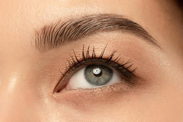 Beautiful young woman's eye close-up shot. Free Photo
