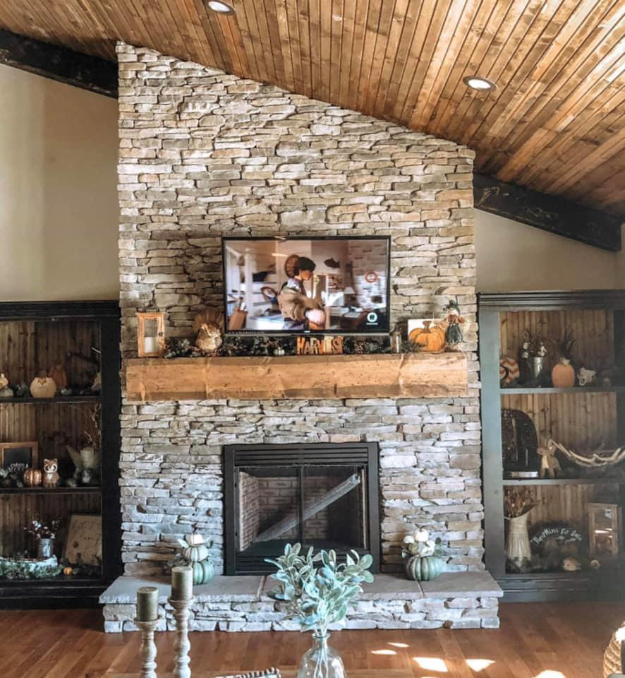 A picture containing indoor, fireplace, living, floor  Description automatically generated