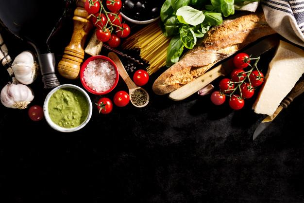 Tasty fresh appetizing italian food ingredients on dark background. ready to cook. home italian healthy food cooking concept. toning. Free Photo