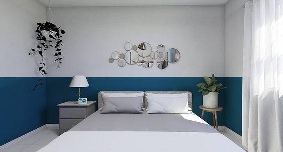 Quarto com pintura com técnica meia parede azul e branca