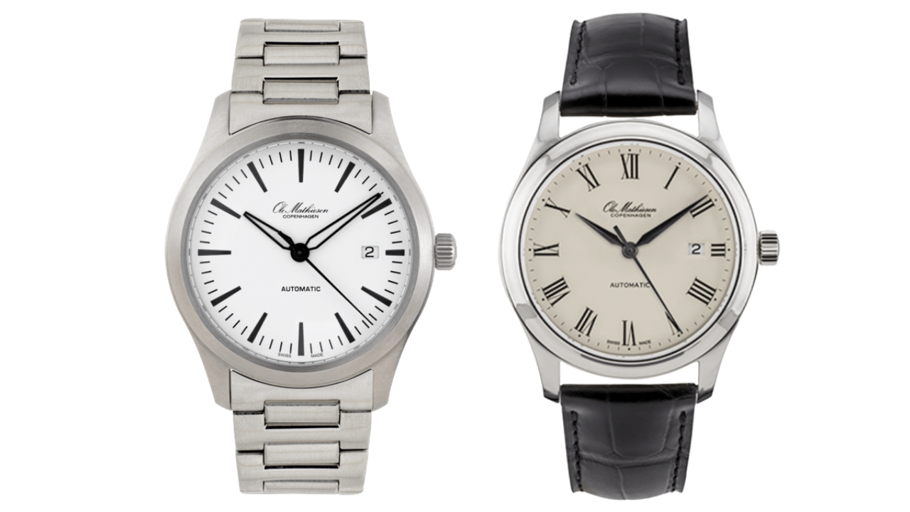 Two watches from the Heritage 1919 collection from Ole Mathiesen. First watch has a silver metal case and band with a white dial. Second watch has a silver metal case and a leather band.