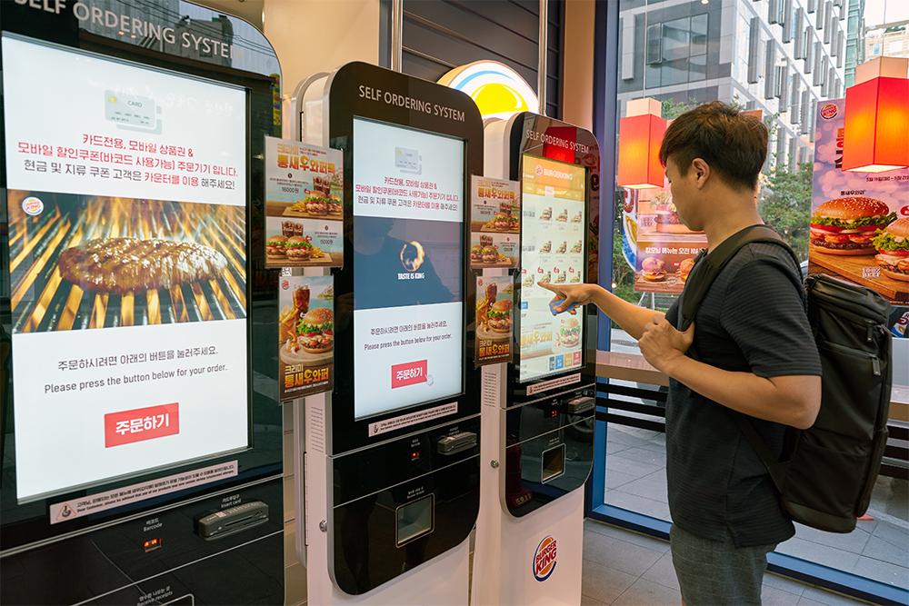 Burger King using touch screen digital menu boards