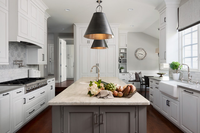 contemporary grey and white kitchen with raised panel cabinets and matte black hardware