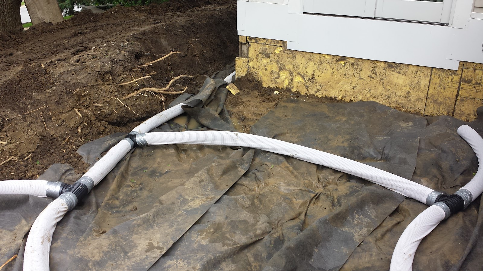 Installation of various drains/swales to alleviate water from the property