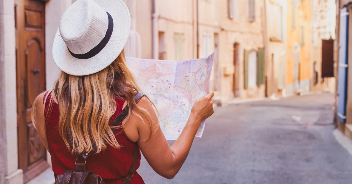 A woman solo traveler with a map