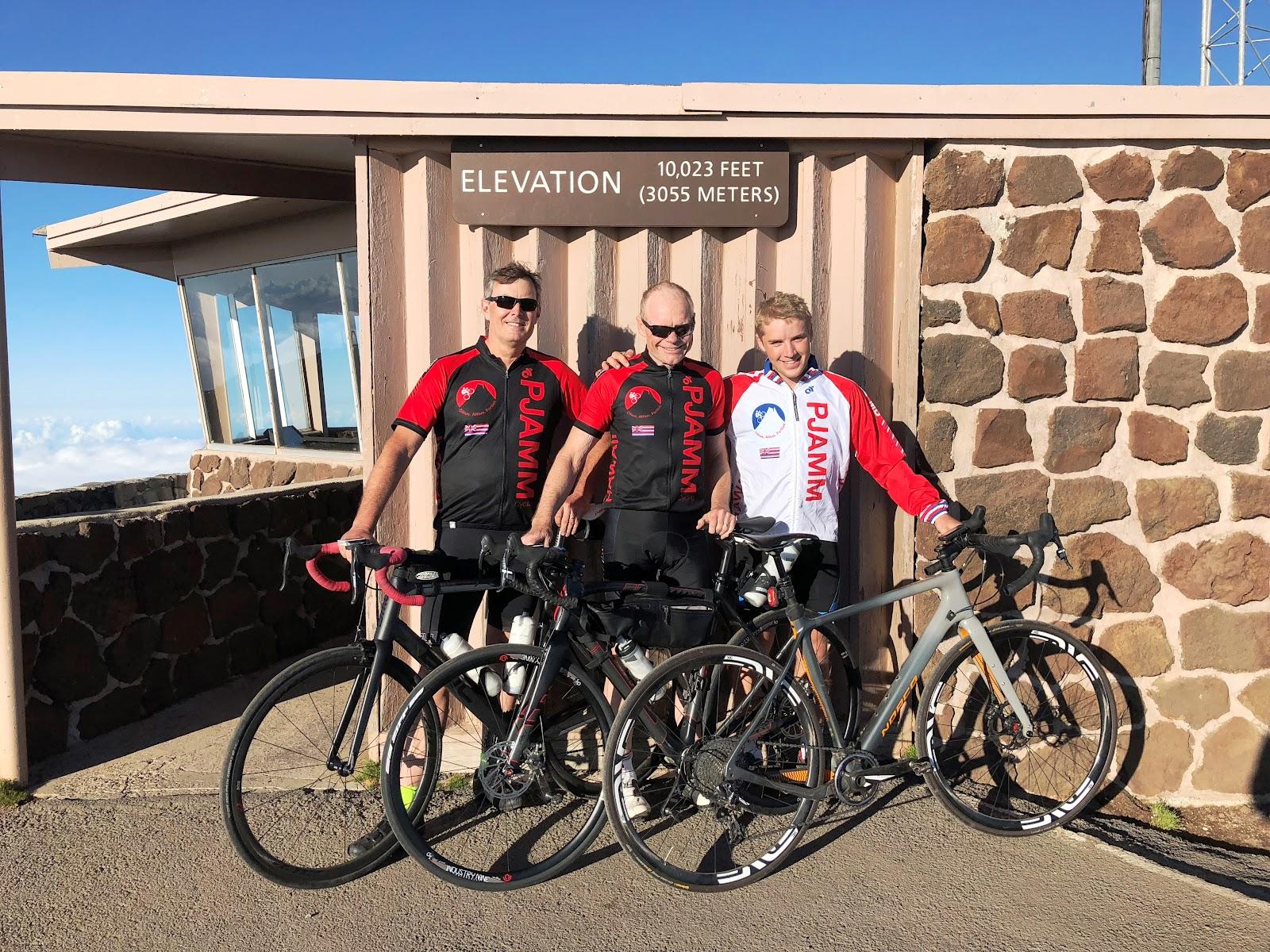 PJAMM cycling Haleakala Volcano  - John Johnson, Brad Butterfield, Bill Cappobianco at summit sign with bikes