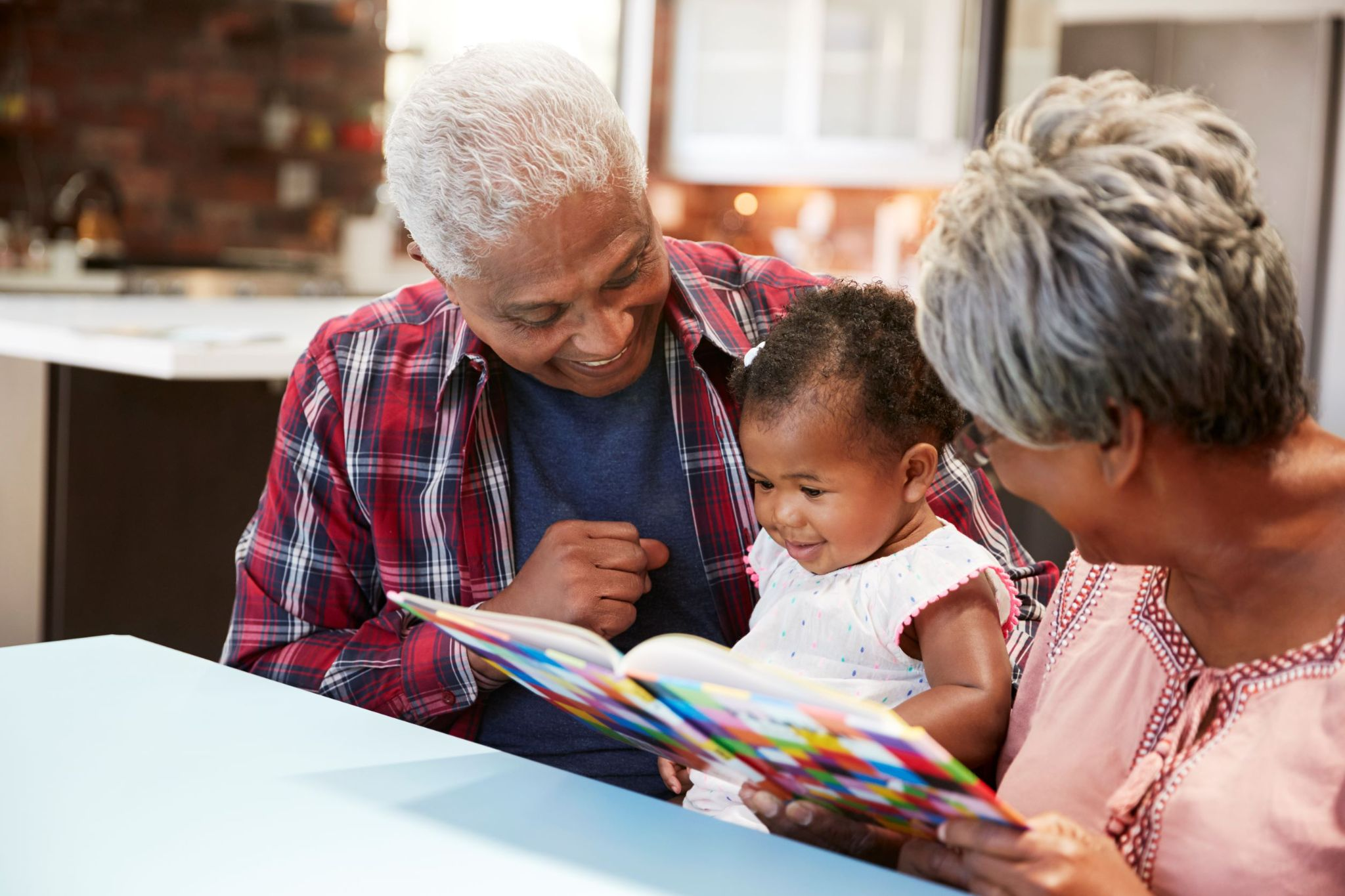grandparents-reading-stories-to-granddaughter
