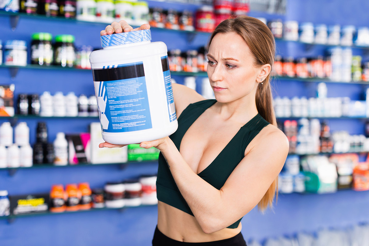 Female athlete shopping for organic whey protein