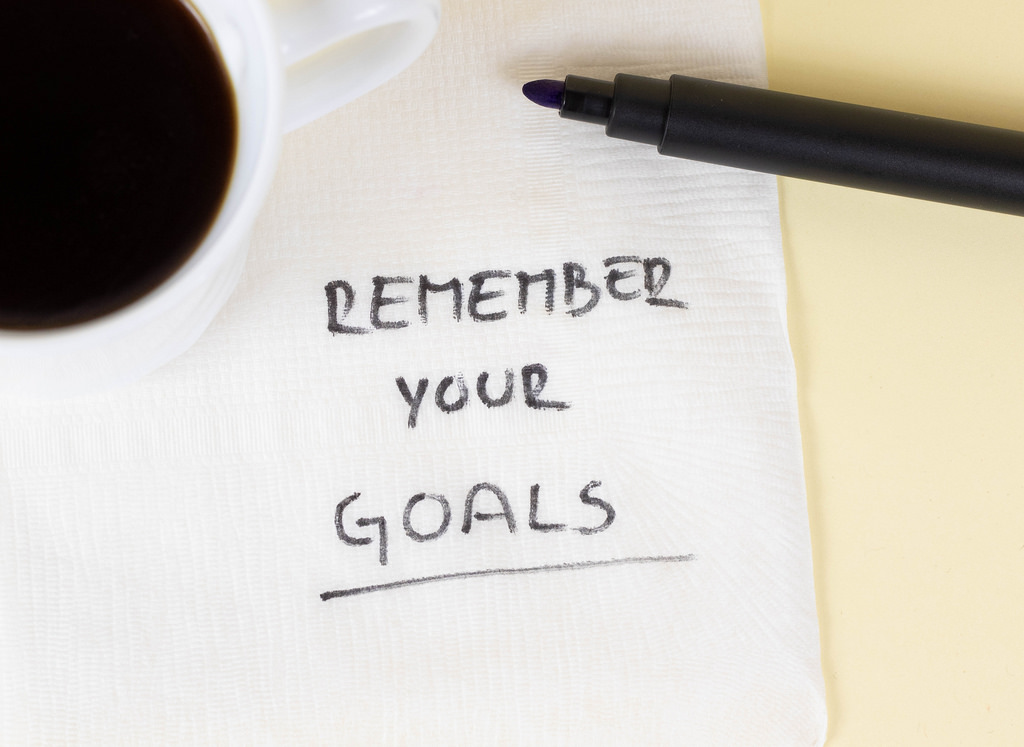 remember your goals written on a notepad your attitude towards your goals