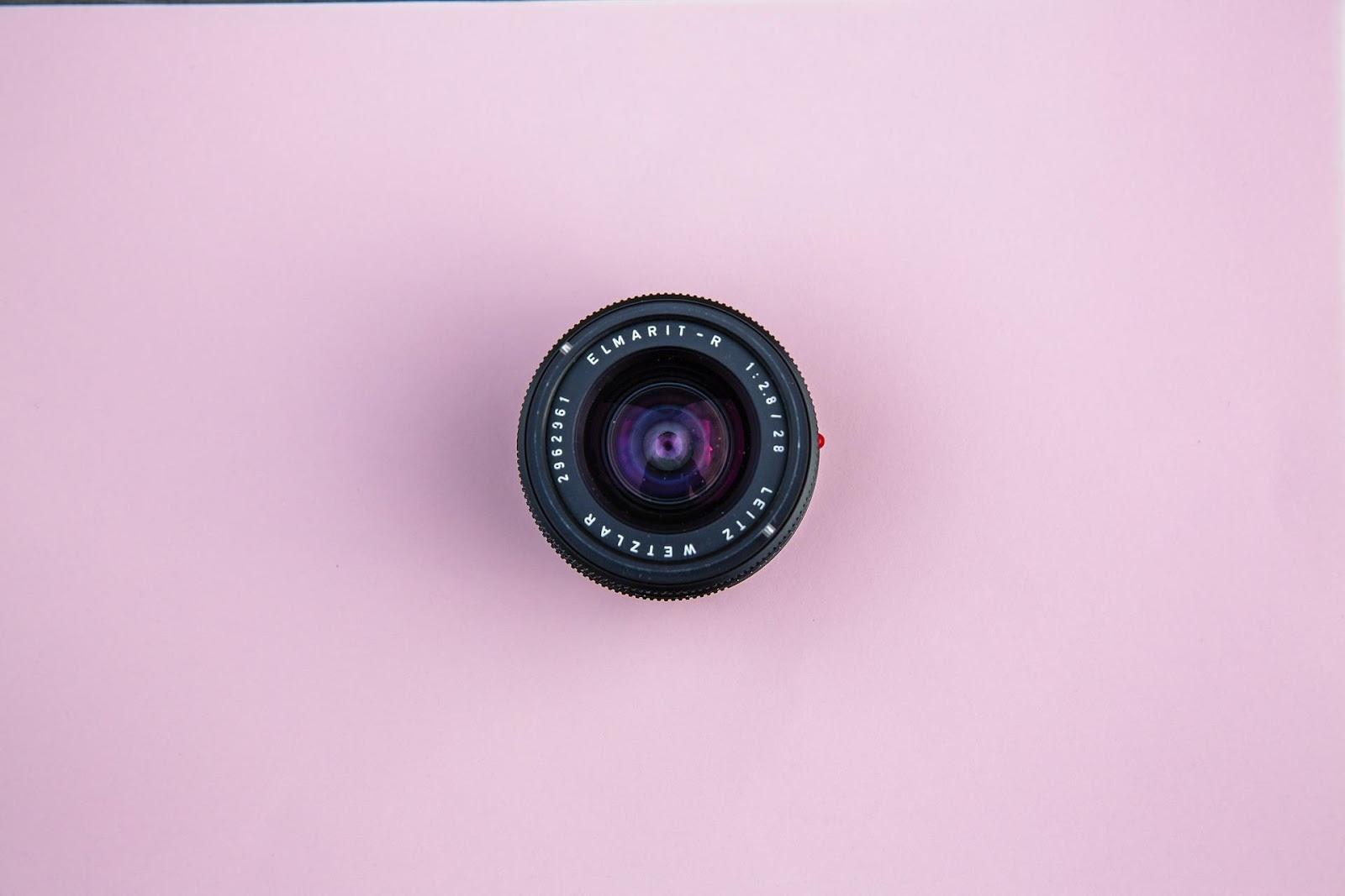 black lens on pink background