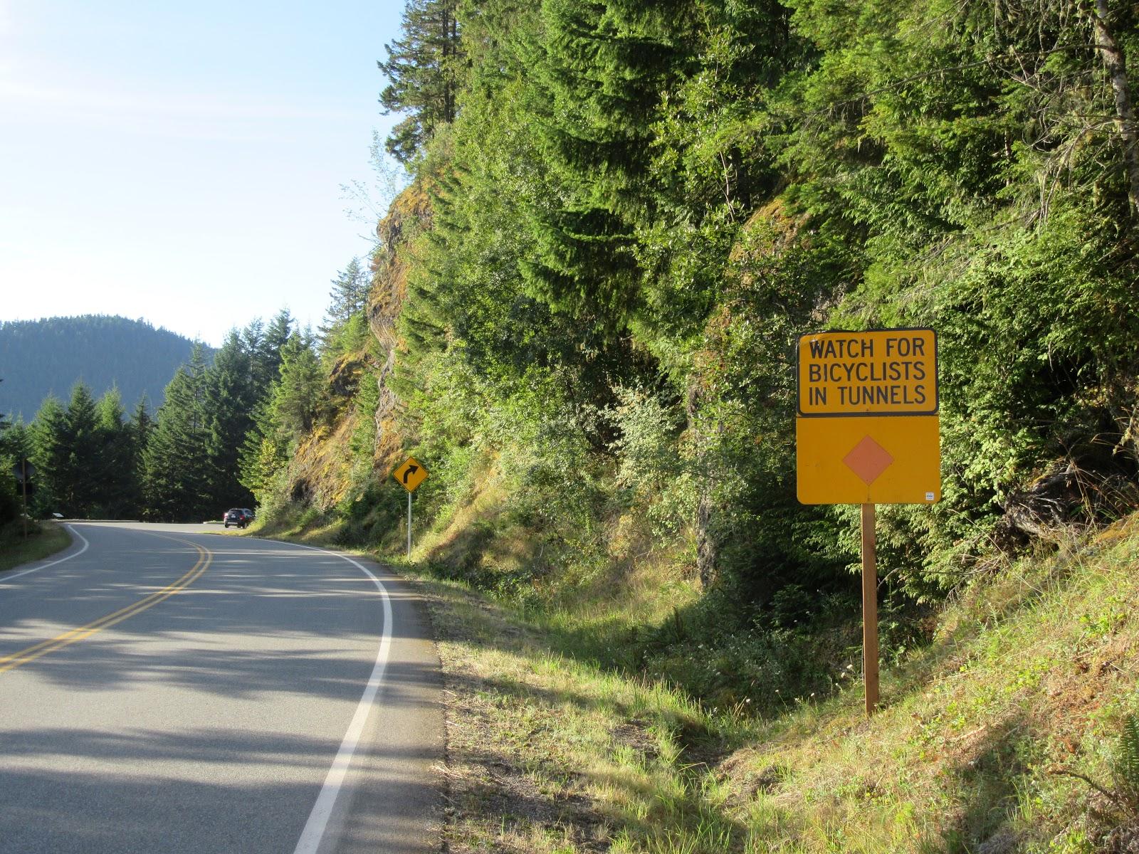 Tunnel and Bike sign on Hurricane Ridge Road during bike climb