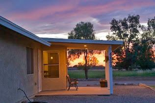 Back patio at sunset for this 2 acre horse property in San Tan Valley