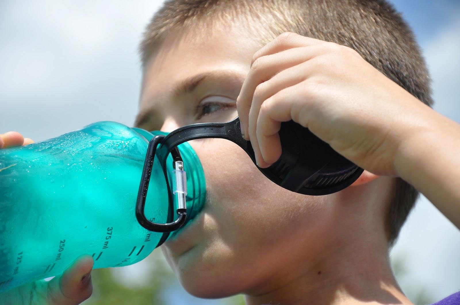 Kid drinking from water bottle