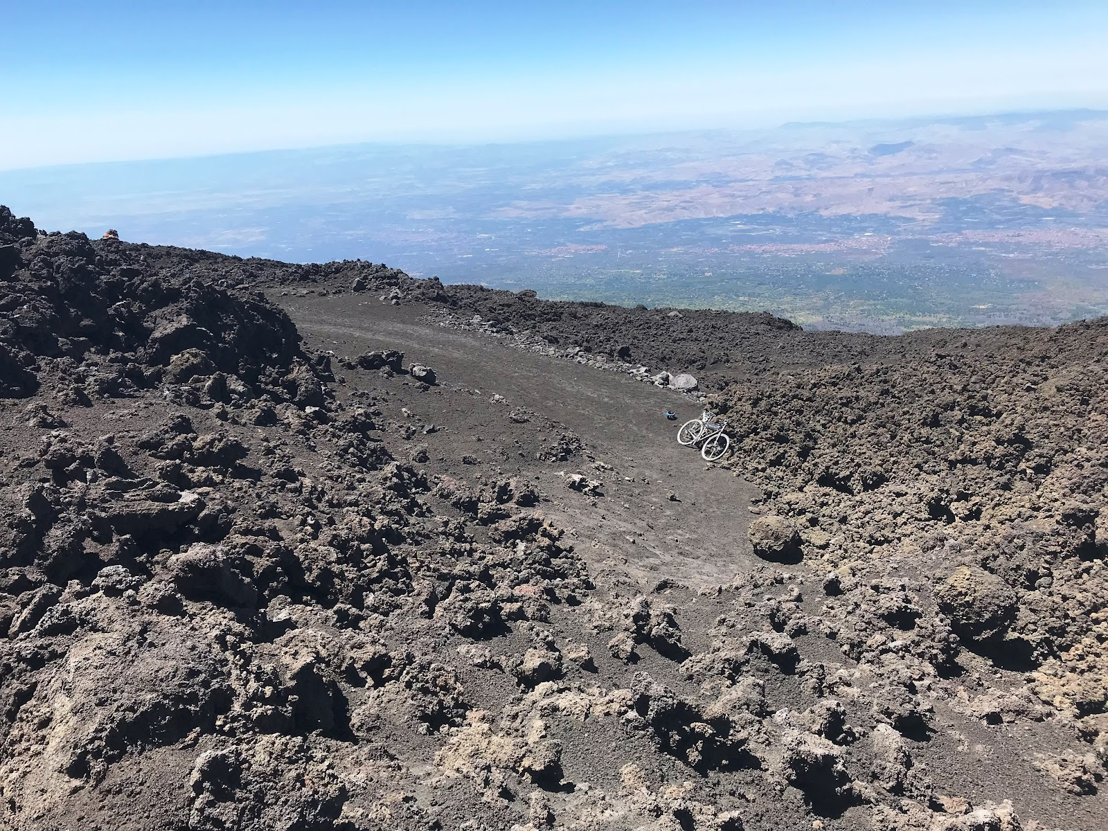 View down at bike from end of road on Mount Etna, Sicily