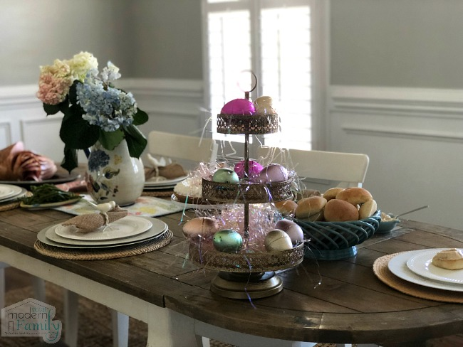 A table decorated with Easter decorations and Easter food.