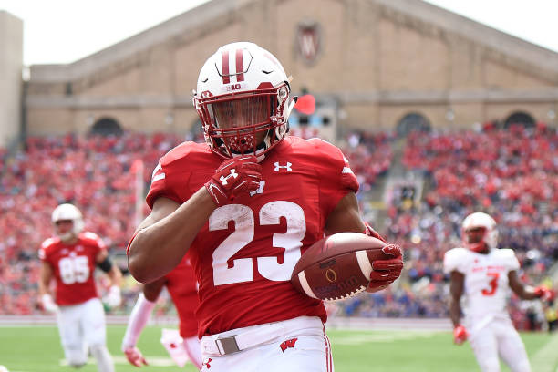 Jonathan Taylor of the Wisconsin Badgers rushes for a touchdown during the first half against the New Mexico Lobos at Camp Randall Stadium on...
