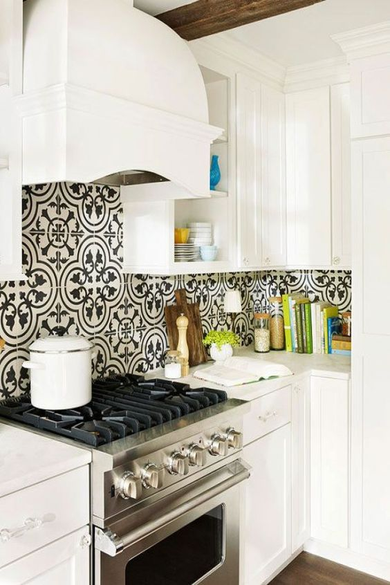 avignon black and white patterned tile with white shaker cabinets, white range hood and stainless steel appliances, white countertops