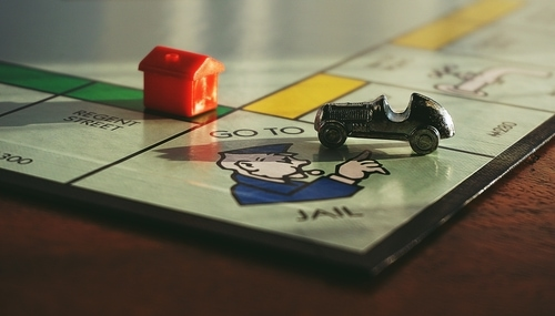 Close up of the go to jail square on a  Monopoly game board