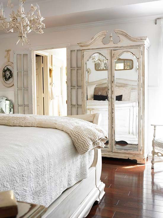 Mirrored Armoire in front of Bed