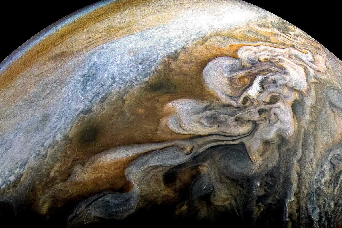 Stunning shot of Jupiter's swirling storms taken by Juno camera | New Scientist