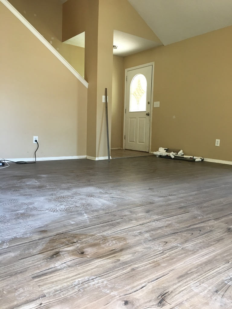 empty-living-room-being-cleaned-for-move