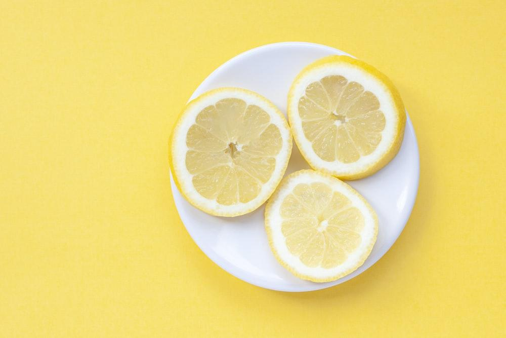 sliced lemon on yellow surface