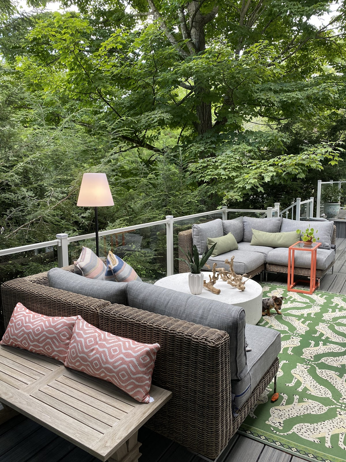 Outdoor patio space on a deck in wooded Pennsylvania backyard