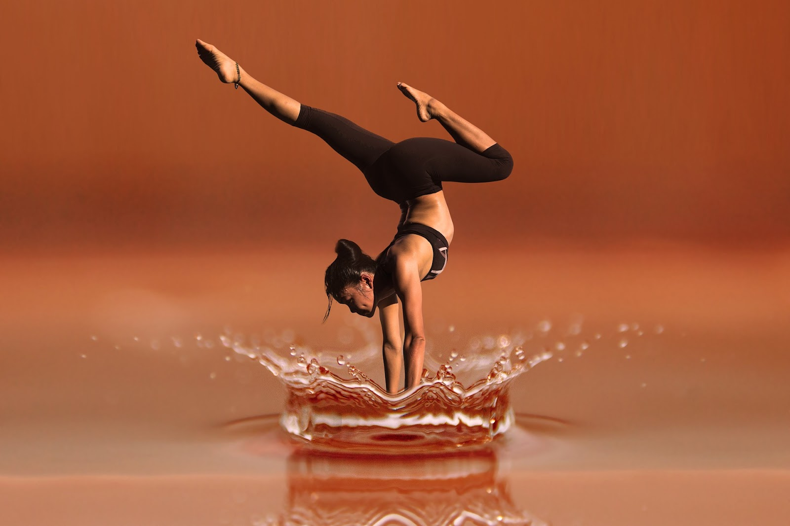 trusii woman balancing on water