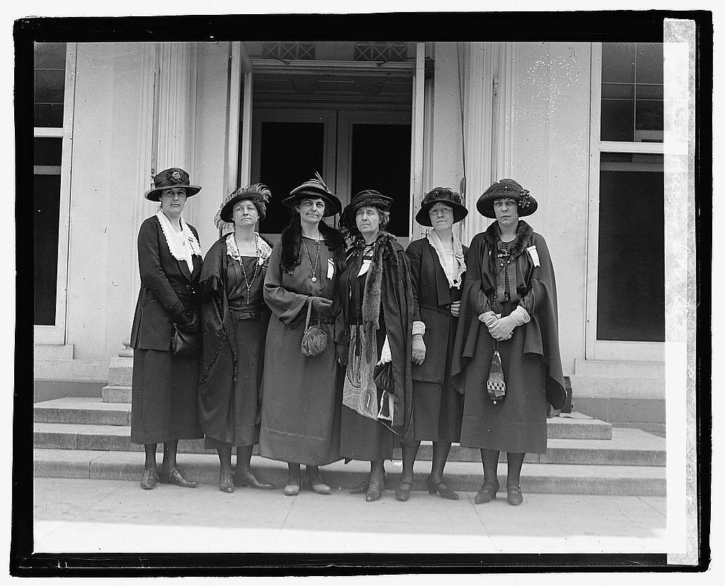 A group of women standing outside a building  Description automatically generated with medium confidence