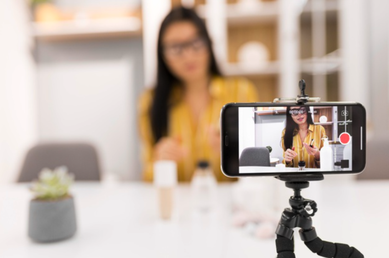Influencer making live video while marketing a brand's product
