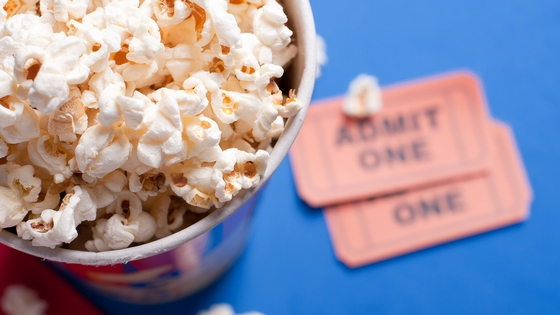 Bowl of popcorn with movie tickets
