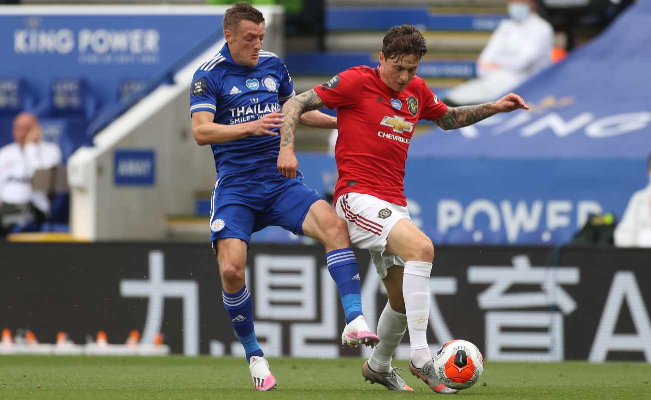 Victor Lindelof of Manchester United shield the ball from Leicester's Jamie Vardy - Photo by Carl Recine/Pool via Getty Images