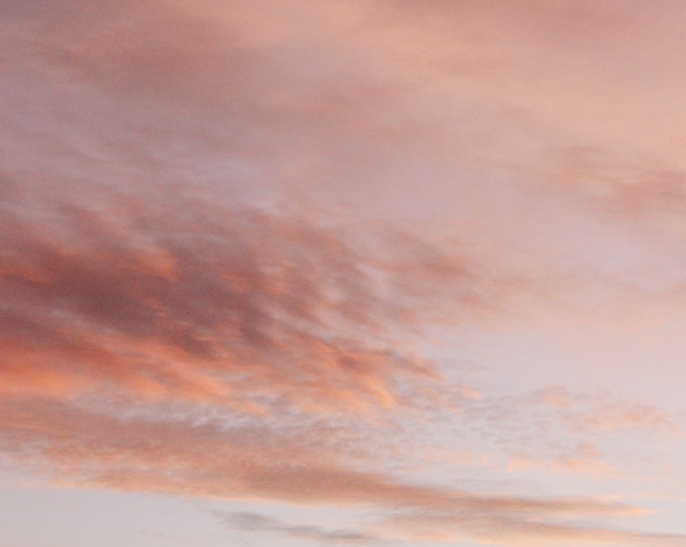 A third photo of the same sunset/sunrise sky. The clouds look like water on the beach, and are pinky-peachy-lilac.