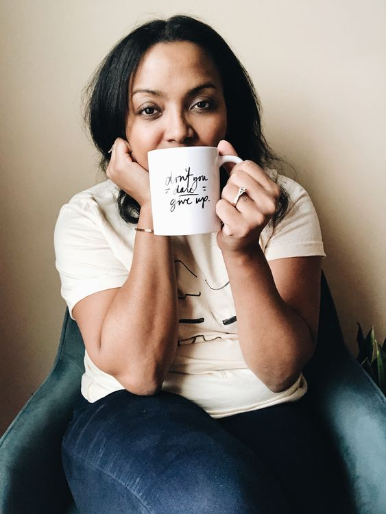 "Women holding mug that says ""Don't you Dare Give Up"""