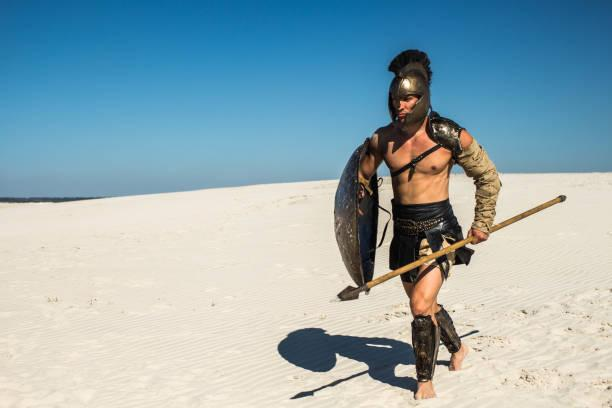 Spartan warrior runs through the desert