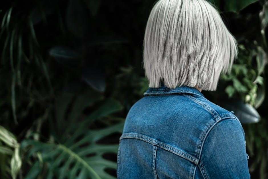 Person Wearing Blue Denim Jacket