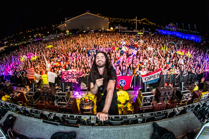 Bassnectar posing on stage in front of his fans at a music festival