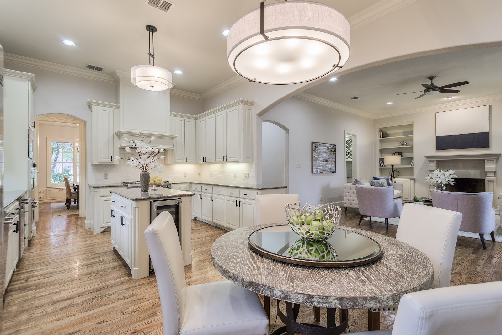 after kitchen white bright open concept west highland park dallas home renovation and staging