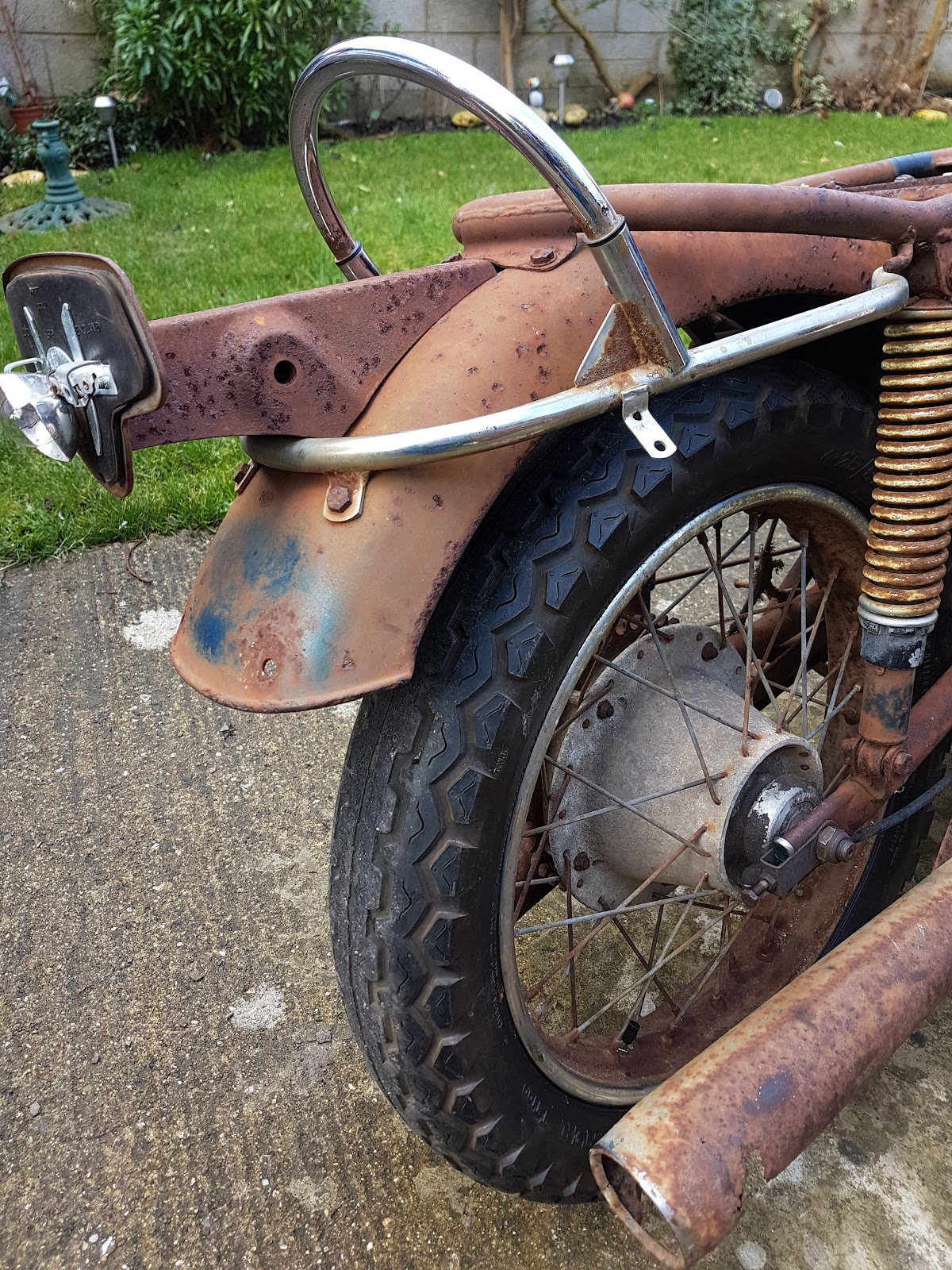 Rusty Triumph T120 rear mudguard tail light and suspension.