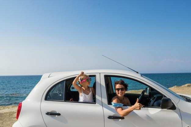 Premium Photo | Happy cheerful woman with daughter standing in car with  arms outstretched and looking at camera. relaxing in a car . trip with car.  happy young women and child enjoying