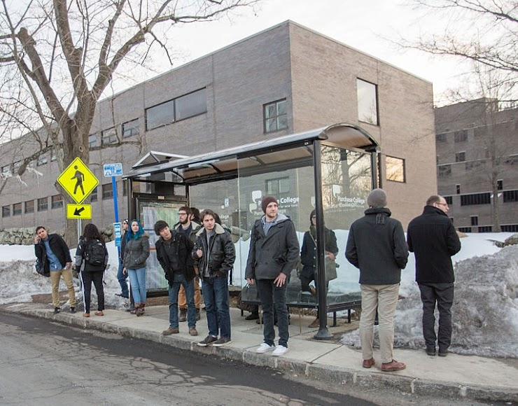 Picture: People waiting at a bus stop.