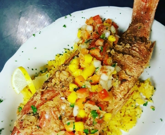 Whole fried snapper with mango salsa from the Stein & Vine restaurant in Brandon, FL.