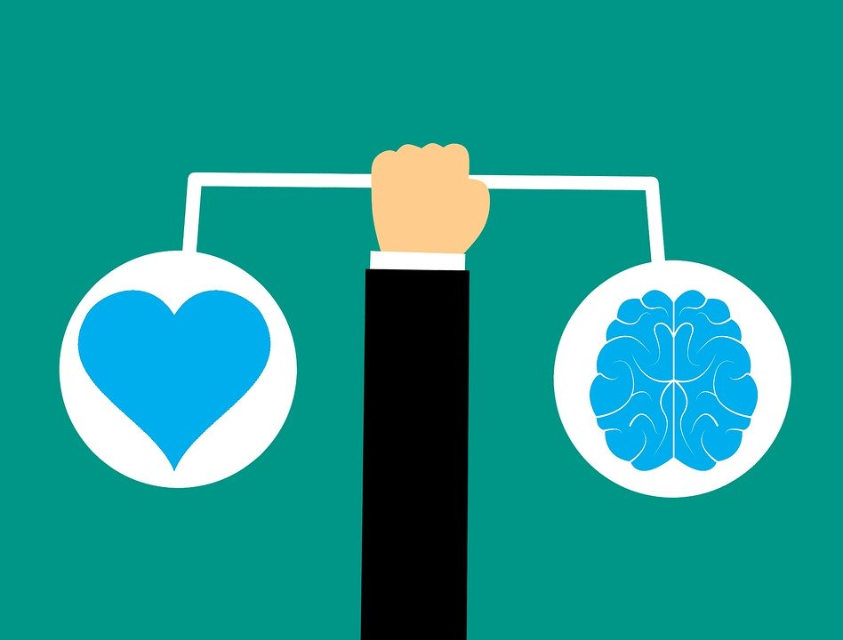 Arm Holding Heart And Brain Illustration