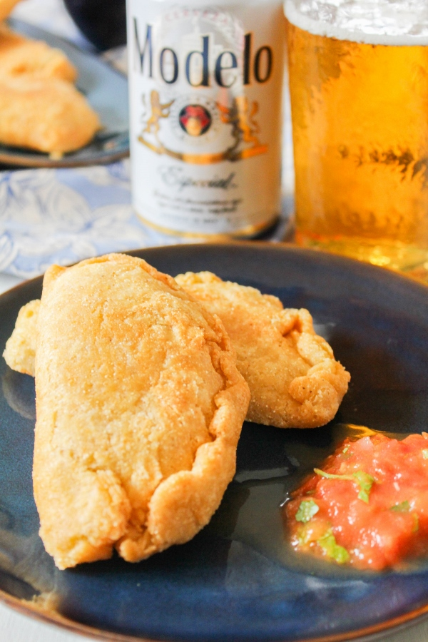 These Chicken and Corn Empanadas with Roasted Red Salsa are fun and easy to make, and are the perfect handheld treat for your Cinco de Mayo celebration!