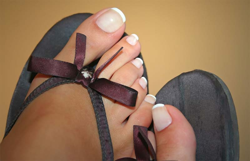 Some sexy feet with nicely painted nails