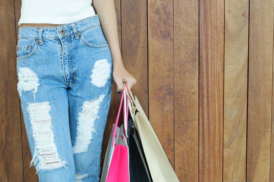 woman in jeans with shopping bag