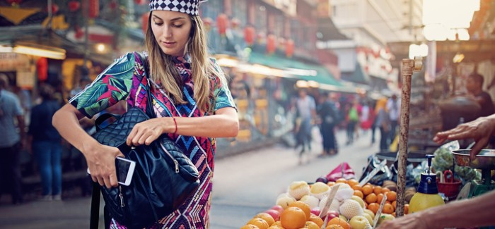Young woman at market stall