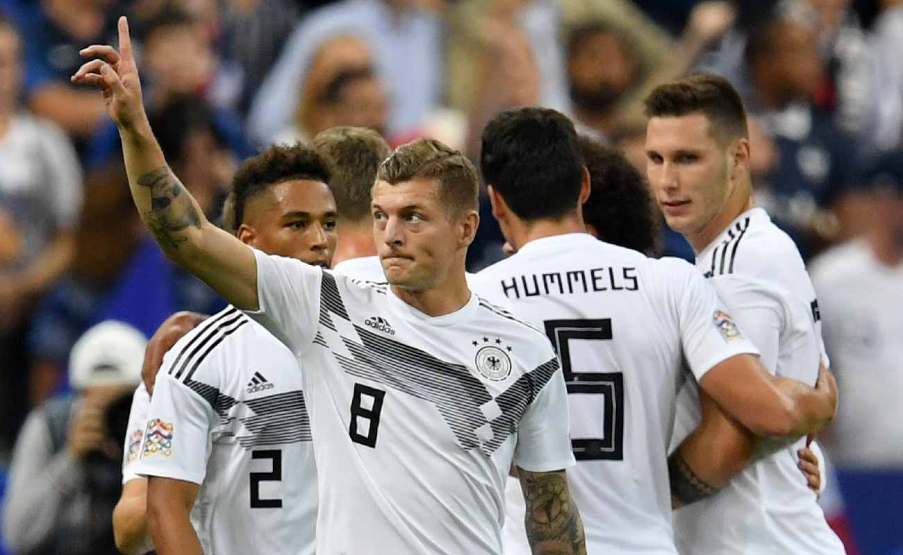 Alt: Toni Kroos lifts his arm in celebration after scoring a goal for Germany - Photo by Matthias Hangst/Bongarts/Getty Images