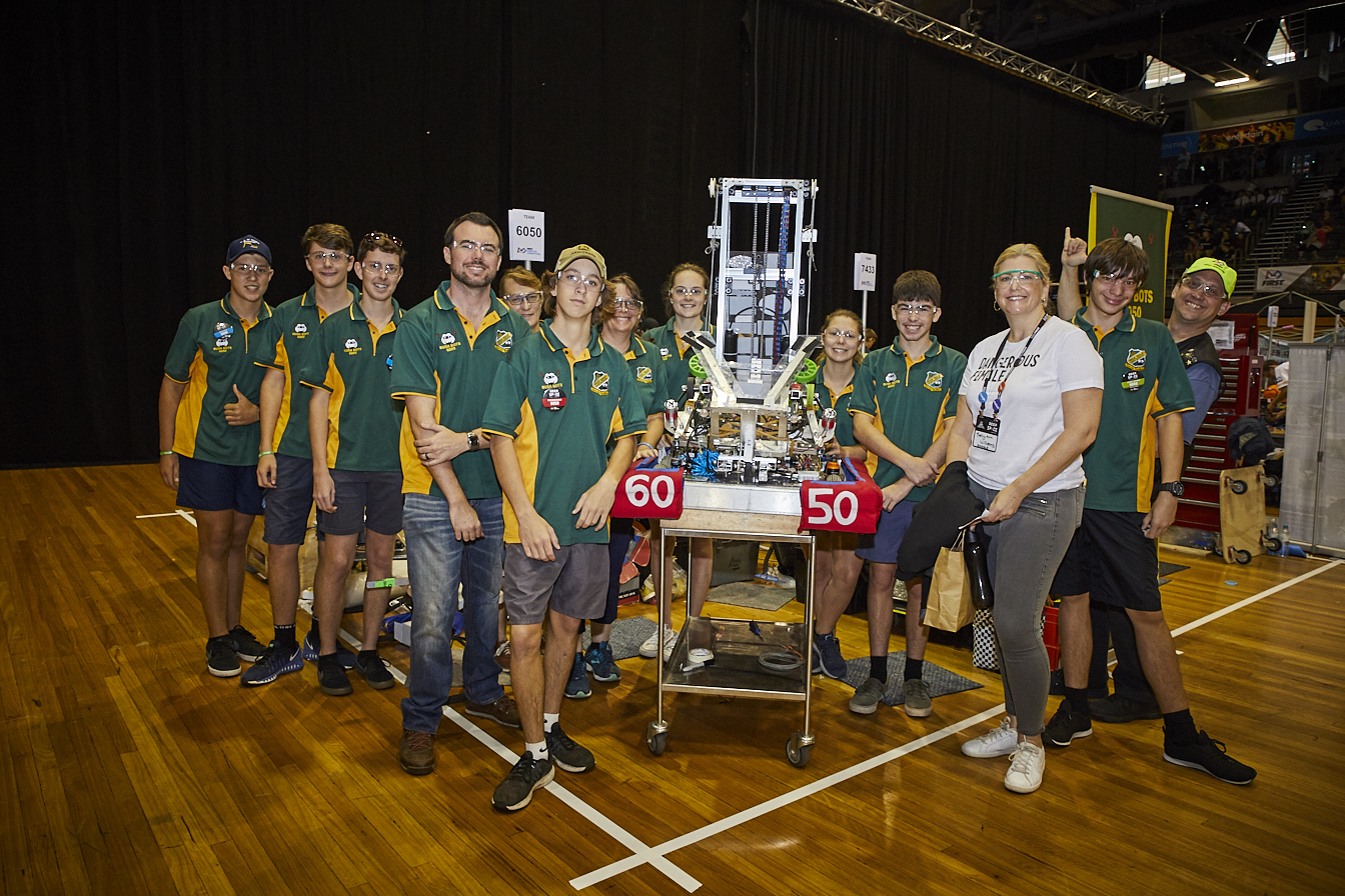 Photo of students with a large contraption at the FIRST Regional Robotics Competition at Sydney Olympic Park